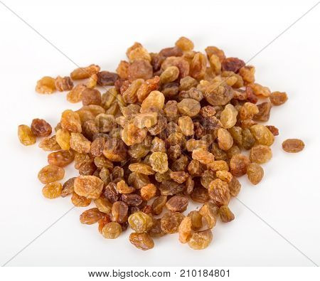 Heap of yellow raisins. Isolated on a white background.