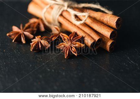 Ceylon Cinnamon sticks in a sheaf on slate
