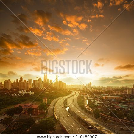 Malaysia capital city landscaped scenary. Kuala Lumpur skyline view in sunset view, square composition.