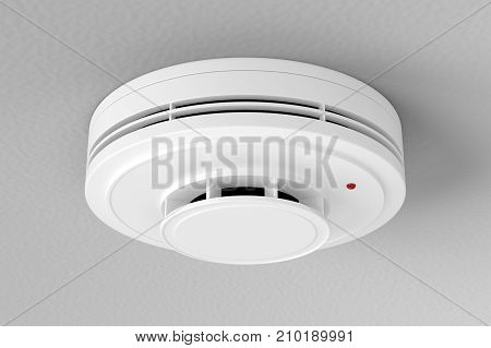 White plastic fire alarm smoke detector with red LED indicator on gray ceiling. 3D illustration