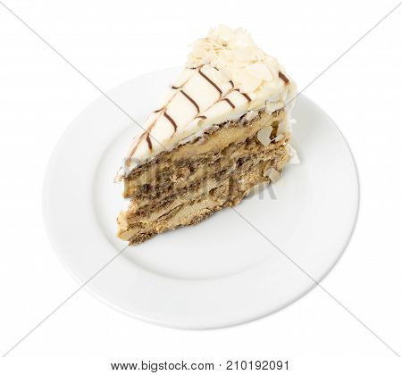 Delicious cake with nuts and white chocolate. Isolated on a white background.