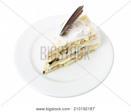 Delicious sponge cake with dried fruits. Isolated on a white background.