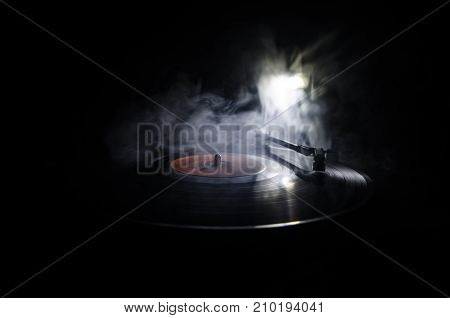Turntable Playing Vinyl With Glowing Abstract Lines Concept On Dark Background. Selective Focus