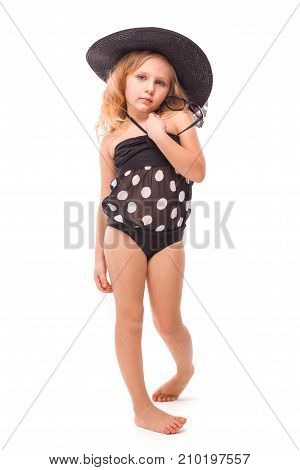Attractive Cute Little Girl In In Black Swimwear And Black Hat Hold Glasses