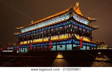 Famous City Wall of the Xi'an city, China. Xi'an is capital of Shaanxi Province and one of the oldest cities in China. City wall is 16 to 18 meters high and over 13 km. long.