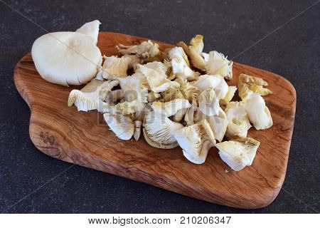 Fried Oyster Mushrooms On Wooden Cutting Board