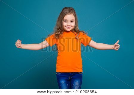 Cute Little Girl In Tee Shirt With Brown Hair
