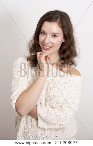 a cute young woman wearing a jumper