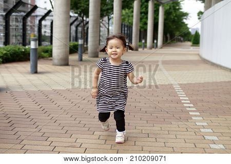 cute running Japanese girl (2 years old)