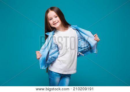 Pretty, Little Girl In Azure Coat With Brunet Hair