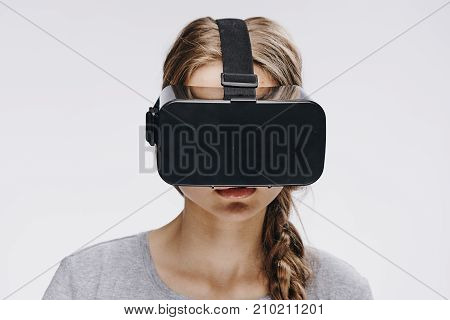 a young woman in 3d glasses on a light background portrait, virtual reality.