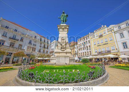 Coimbra, Portugal - August 14, 2017: bronze statue erected in honor of Joaquim Antonio de Aguiar in Largo de Portagem square. Historic medieval district in Coimbra in Central Portugal, Europe.