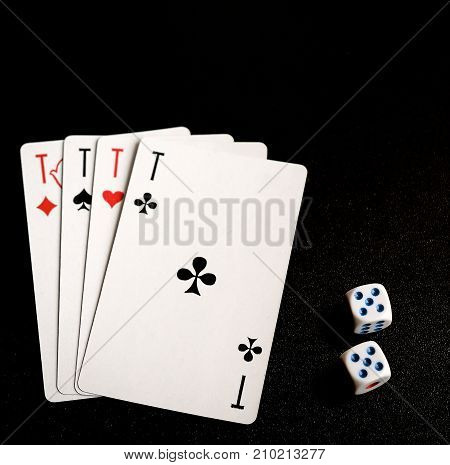 four aces on the black background and two dice