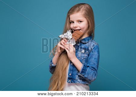 Little Pretty Girl In Jean Jacket With Long Brown Hair Hold Candy Bar