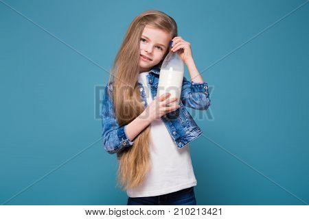 Little Pretty Girl In Jean Jacket With Long Brown Hair Hold Container With Milk