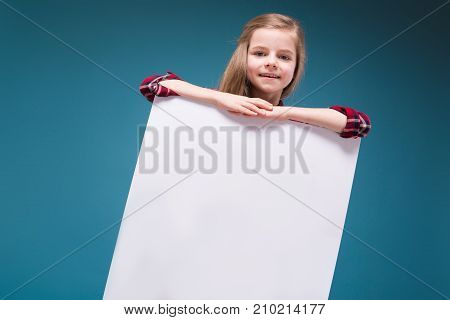 Pretty Girl In Shirt With Long Hair Hold The White Paper
