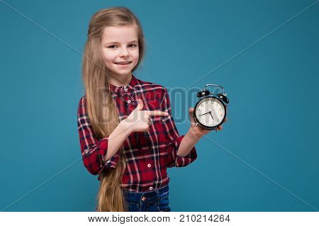 Pretty Girl In Shirt With Long Hair Hold The Clock
