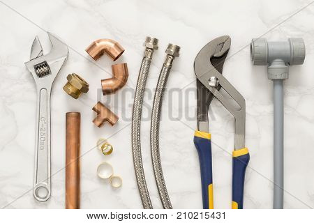 Plumbing Tools And Materials On Marble Background