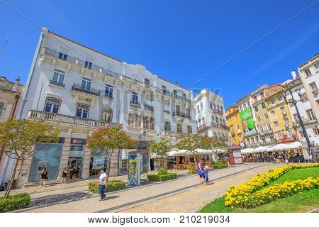 Coimbra, Portugal - August 14, 2017: people walking in Largo de Portagem square. Historic medieval district in lower Coimbra, Central Portugal, Europe.
