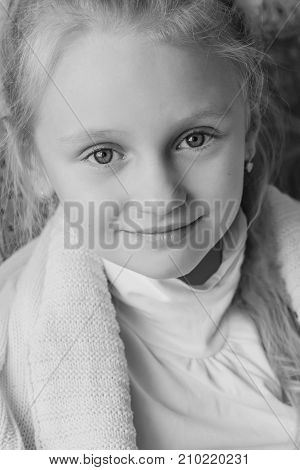 portrait of a little cute girl wrapped in a blanket ( black and white )