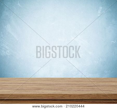 Empty wooden table over grunge cement wall vintage background template product display montage