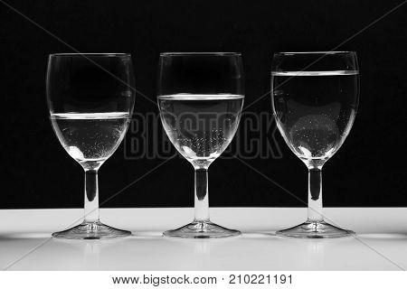 Transparent glasses with water growing business chart.