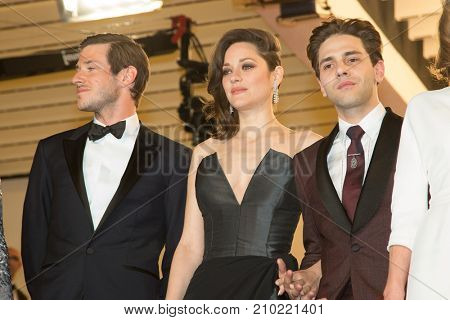 CANNES, FRANCE - MAY 19, 2016: Gaspard Ulliel, Marion Cotillard , Xavier Dolan attend the 'It's Only The End Of The World (Juste La Fin Du Monde)'  premiere during the 69th annual Cannes Film Festival