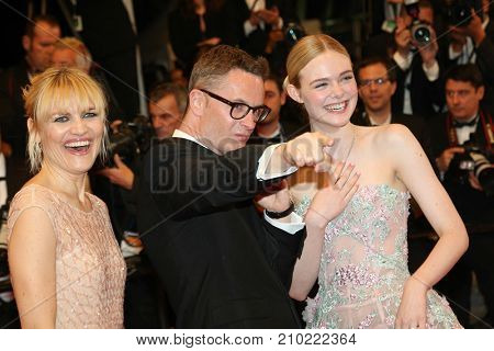 CANNES, FRANCE - MAY 20, 2016: Nicolas Winding Refn, Liv Corfixen, Elle Fanning  attends the 'The Neon Demon' Premiere. 69th annual Cannes Film Festival at the Palais des Festivals