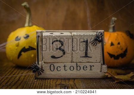 Halloween concept - pumpkins and symbols, rustic wood background