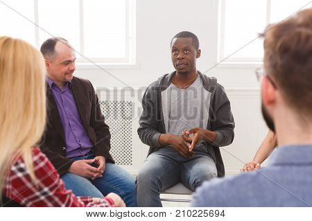 Meeting of support group. African-american man talking about his life, telling his problems and issues. Mental health, psychotherapy concept