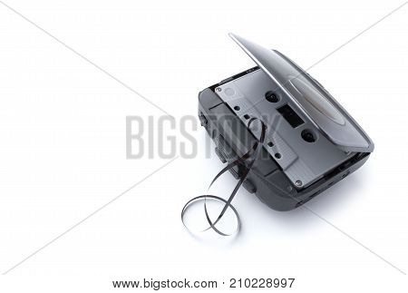 Old cassette player and cassette tape isolated on white background