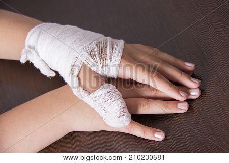 Bandaged woman's hand hand injury bandage bandage.