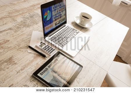 Stock market calculations with a calculator and research software on a Tablet PC with a Laptop computer.