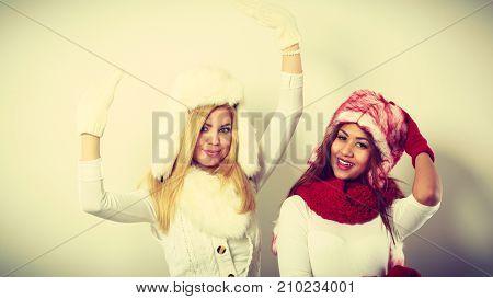 Two Girls Warm Winter Clothing Having Fun.
