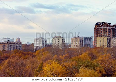 autumn city view from the height park old houses new buildings moscow suburb before sunset