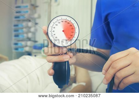 Blood pressure check in the intensive care unit.