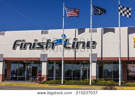 Indianapolis - Circa October 2017: Finish Line Inc. Retail Strip Mall Location with the US Indiana and Checkered Flags. Finish Line is a retailer offering footwear and accessories III