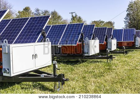 Indianapolis - Circa October 2017: Mobile Photovoltaic Solar Panels on trailers. The ultimate in portable and emergency power each unit is also equipped with a generator V