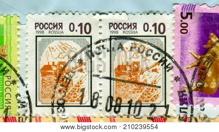 GOMEL, BELARUS, 13 OCTOBER 2017, Stamp printed in Russia shows image of the Combine harvester, circa 1998.