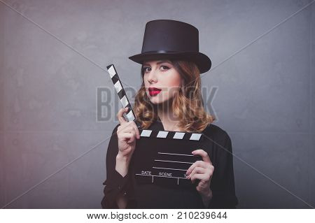 Style Redhead Girl In Top Hat With Movie Clapperboard