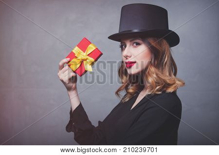 Redhead Girl In Top Hat With Gift Box