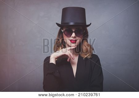 Style And Mystique Redhead Girl In Top Hat And Sunglasses