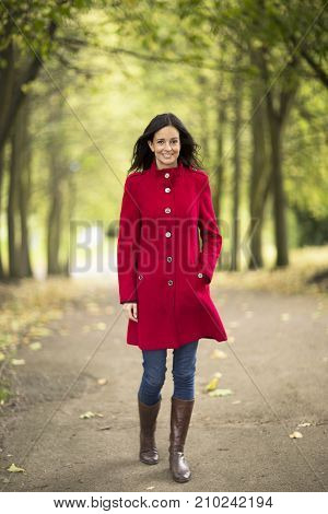 young woman having a walk in the park