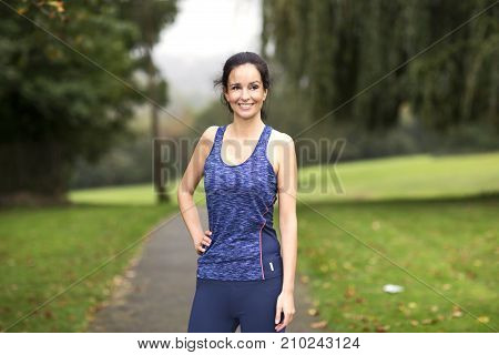 a fitness woman in the park posing