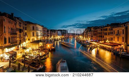 Speed motion on the Grand Canal at night in Venice, Italy. Grand Canal is one of the major water-traffic corridors in Venice.