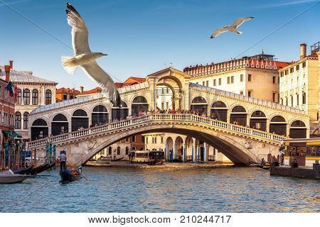 The old Rialto Bridge over the Grand Canal in Venice, Italy. Rialto Bridge (Ponte di Rialto) is one of the main tourist attractions of Venice.