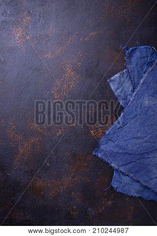 Blue linen tablecloth on concrete background. Top view