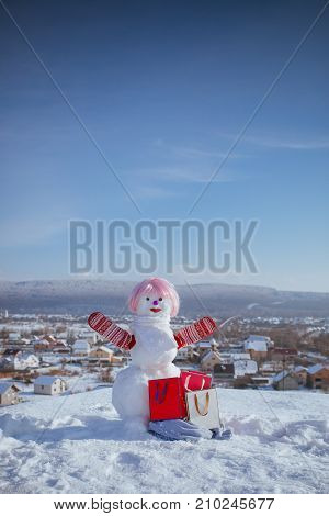 Snowman In Pink Wig And Mittens With Gift Pack.