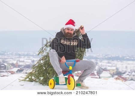 Cyclist In Santa Hat And Sporty Wear On Winter Day
