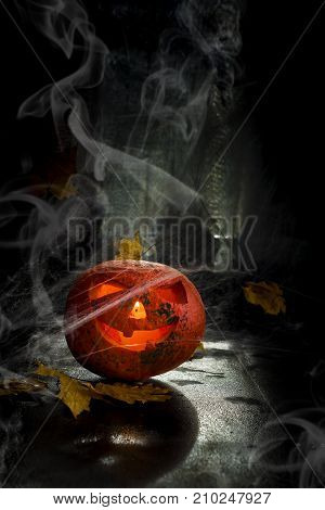 Halloween pumpkin head with spiderweb. Scary evil face spooky holiday. Helloween part. Helloween attributes. copy space